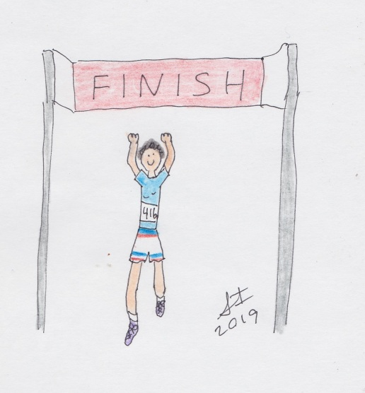 Runner crossing finish line with arms up