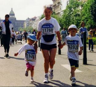 Woman running in a race with two small kids